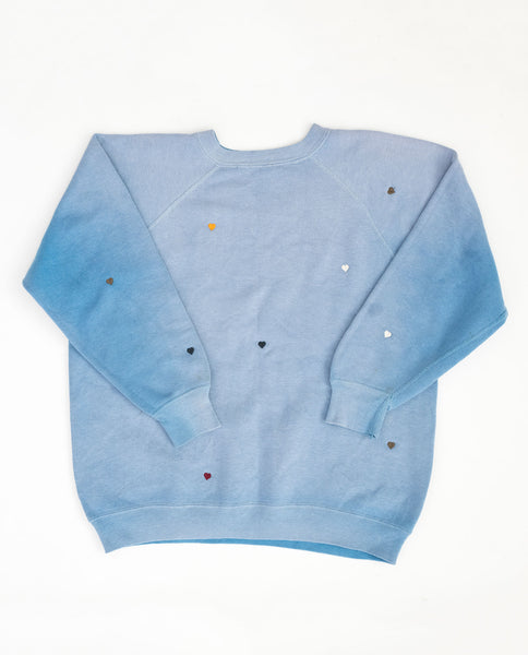 The Vintage College Sweatshirt. -- Summer Sky with Multi Heart Embroidery and Augustana Graphic