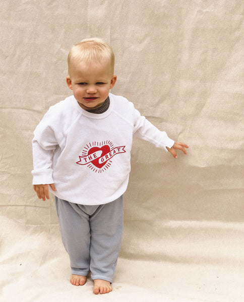 The Little College Sweatshirt. -- True White with Mini Heart Graphic