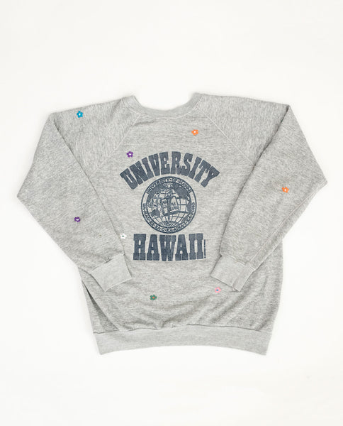 The Vintage College Sweatshirt. -- Heather Grey with Multi Flower Embroidery and University of Hawaii Graphic