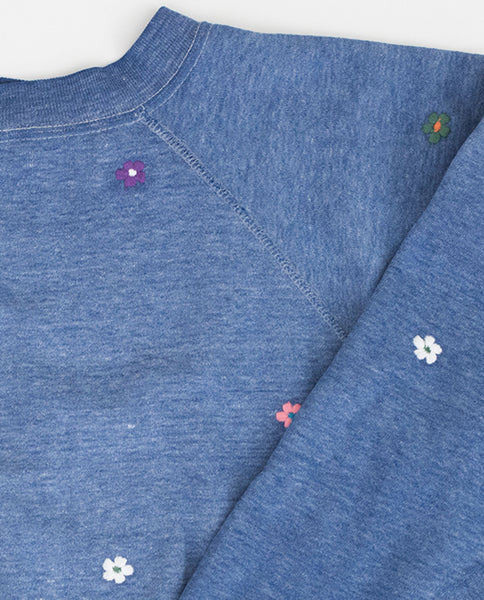 The Vintage Solid Sweatshirt. -- Heather Blue with Multi Flower Embroidery