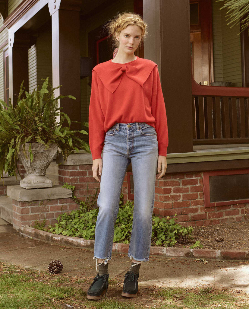 The Bow Sweater. -- POINSETTIA