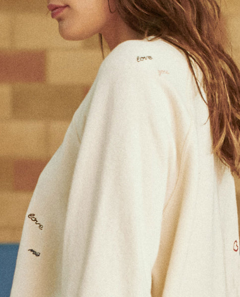 The College Sweatshirt. Embroidered. -- WASHED WHITE WITH DOODLE EMBROIDERY