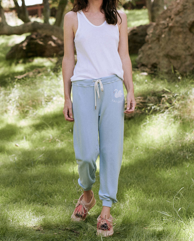 The Cropped Sweatpant. -- PALE BLUE WITH SWAN GRAPHIC