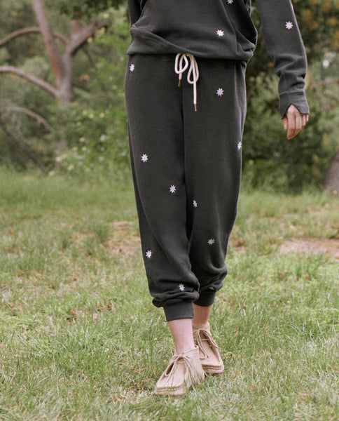 The Cropped Sweatpant. Graphic -- WASHED BLACK WITH BADGE EMBROIDERY