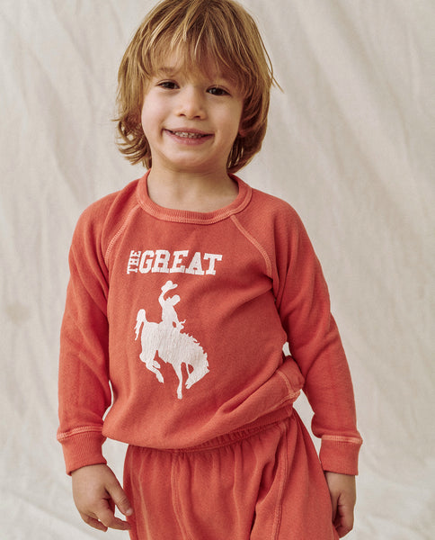 The Little College Sweatshirt. GRAPHIC -- PERSIMMON WITH COWGIRL GRAPHIC
