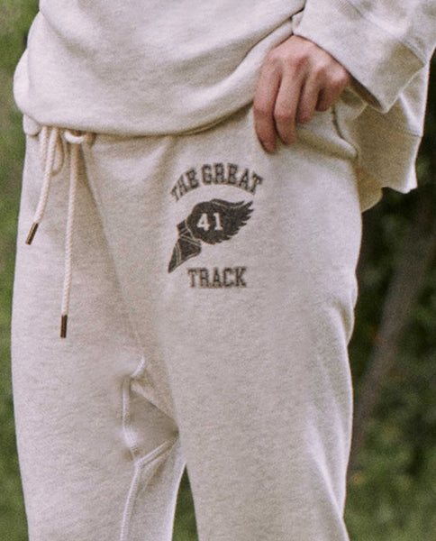 The Warm Up Sweatpant. -- FADED OATMEAL WITH TRACK GRAPHIC