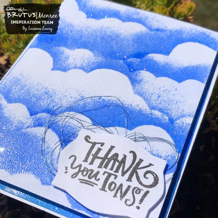 Cloud stenciling with this month's embossing powder