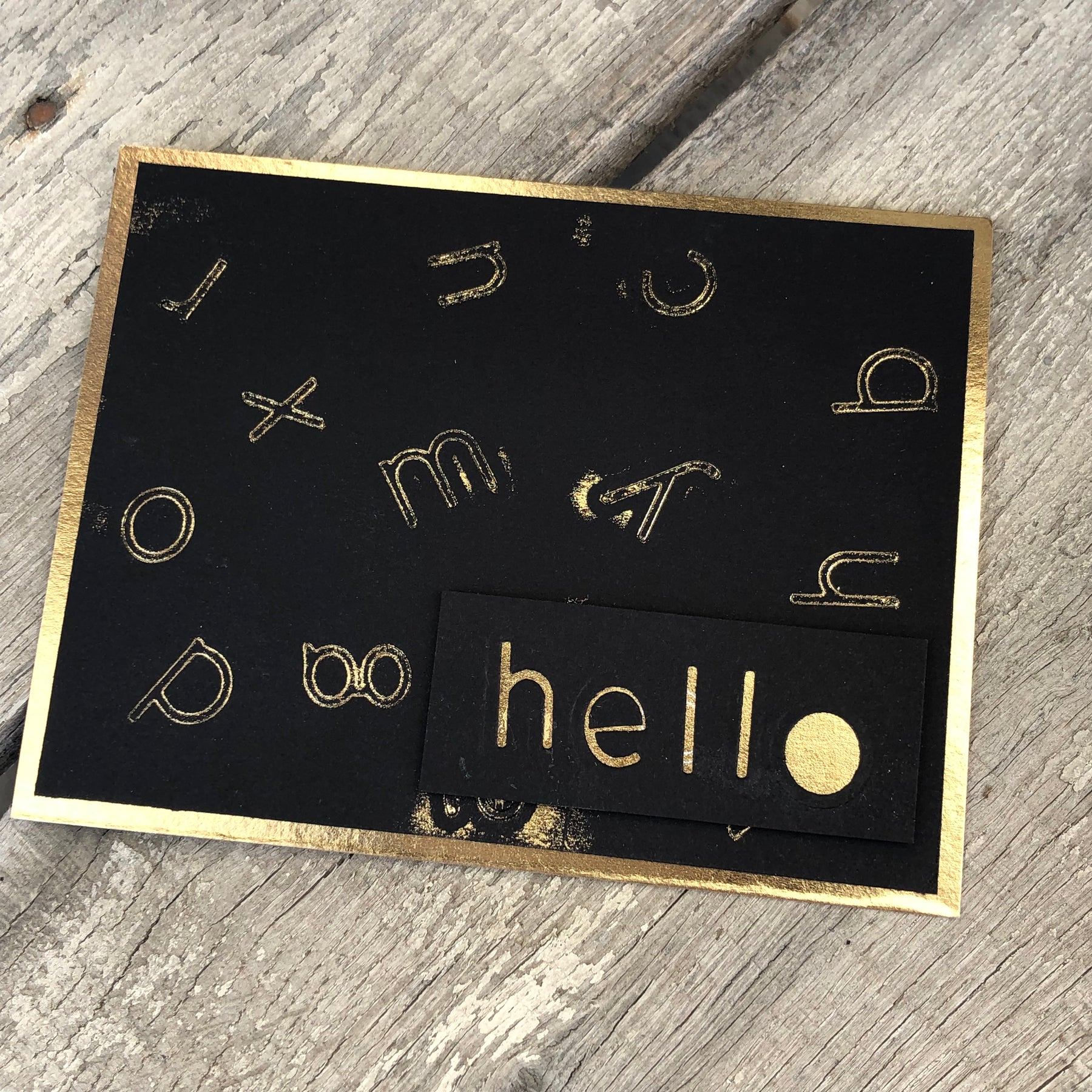 Foiled card with alphabet dies.