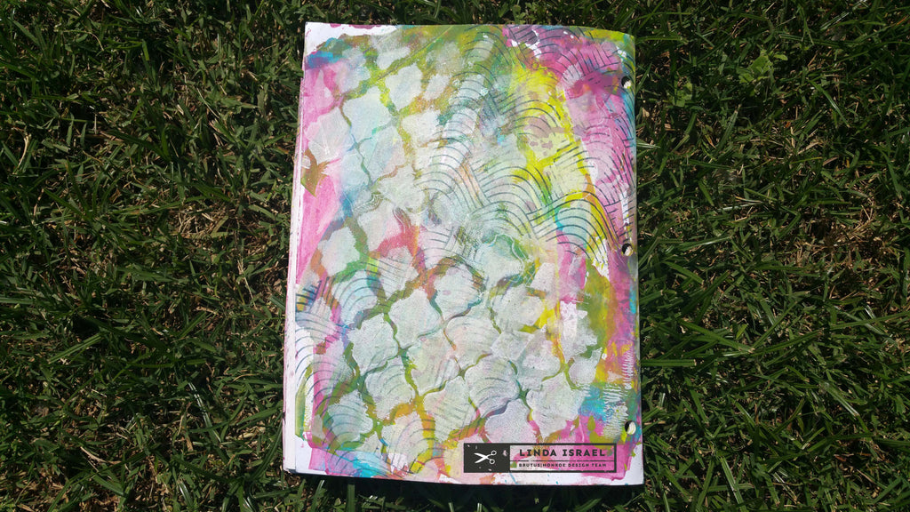 Altered workbook with Paint Stamps Stencils and Glimmer Mists