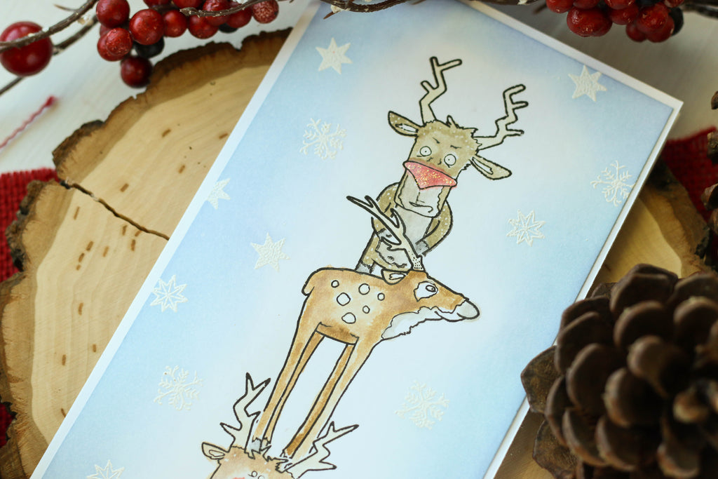Brutus Monroe's reindeer stamps on this long and skinny card! Lots of masking and coloring went into creating this fun Christmas scene!