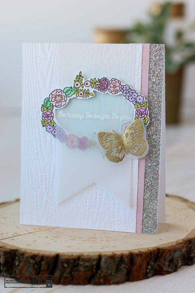 Brutus Monroe's Floral Frame stamp set used on this handmade card. How pretty!