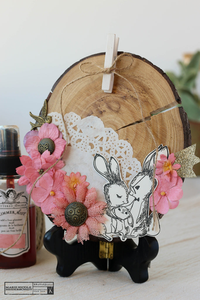 "Brutus Monroe's new stamp set, ""Bunny Kisses"", used to embellish a photo frame made from a wood slab!"