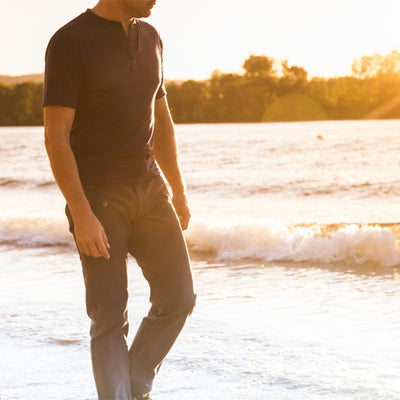 Thunderbolt Sportswear Baseline Henley - 100% Merino 18.5 Micron 170GSM on beach at sunset