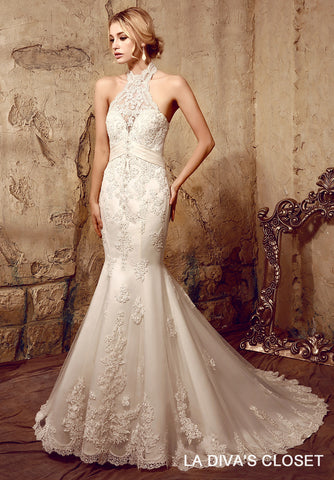 CHANTILLY LACE GOWN DECORATED WITH LACE APPLIQUES AND SCALLOPED HEMLINE.