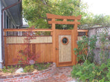 "This is gate A-10 made from Western Red Cedar, with bamboo, and a 1/4"" thick bronze symbol in the center of the circle (installed version)"