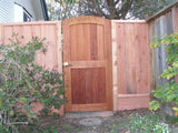 This image is of a P-20 gate in Clear Redwood with a light bronze squirrel tail latch