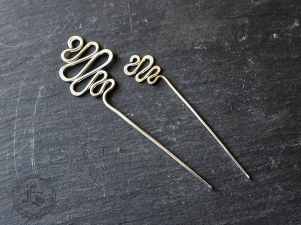 Angrboda. Simple stick pin for handknits in hand forged sterling.