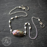 The Draugen Necklace in Sterling Silver with Abalone and Freshwater Pearls.