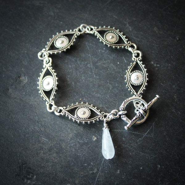 The Droch Shùil Evil Eye Link Bracelet with Quartz Tear.