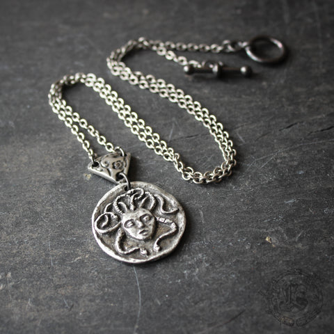 Medusa Ouroboros Necklace.