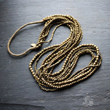 The Bold River. Long Vintage Naga Tribe Brass and Hemp Necklace.