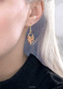 Spotted amber earrings with gold