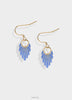 Glowing dusty blue earrings with gold