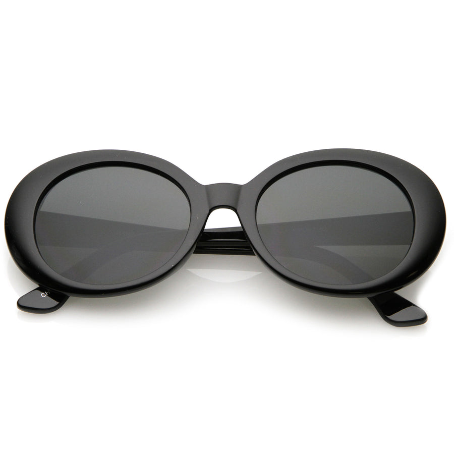0a9804d64c Retro Oval Sunglasses Tapered Arms Neutral Colored Round Lens 53mm