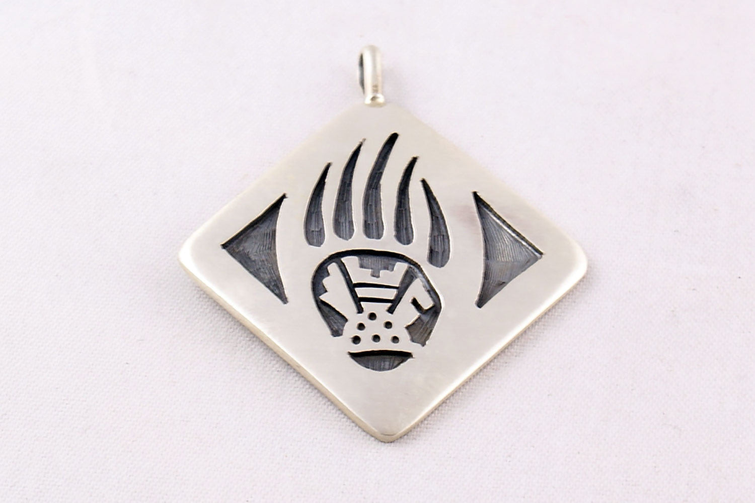 Hopi Overlay Sterling Silver Bear Paw And Prayer Feather Pendant By