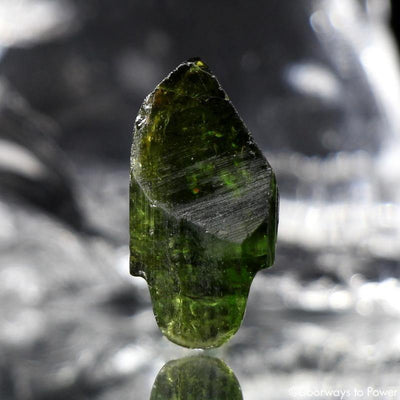 Had Carved Green Tourmaline Crystal Skull Talisman
