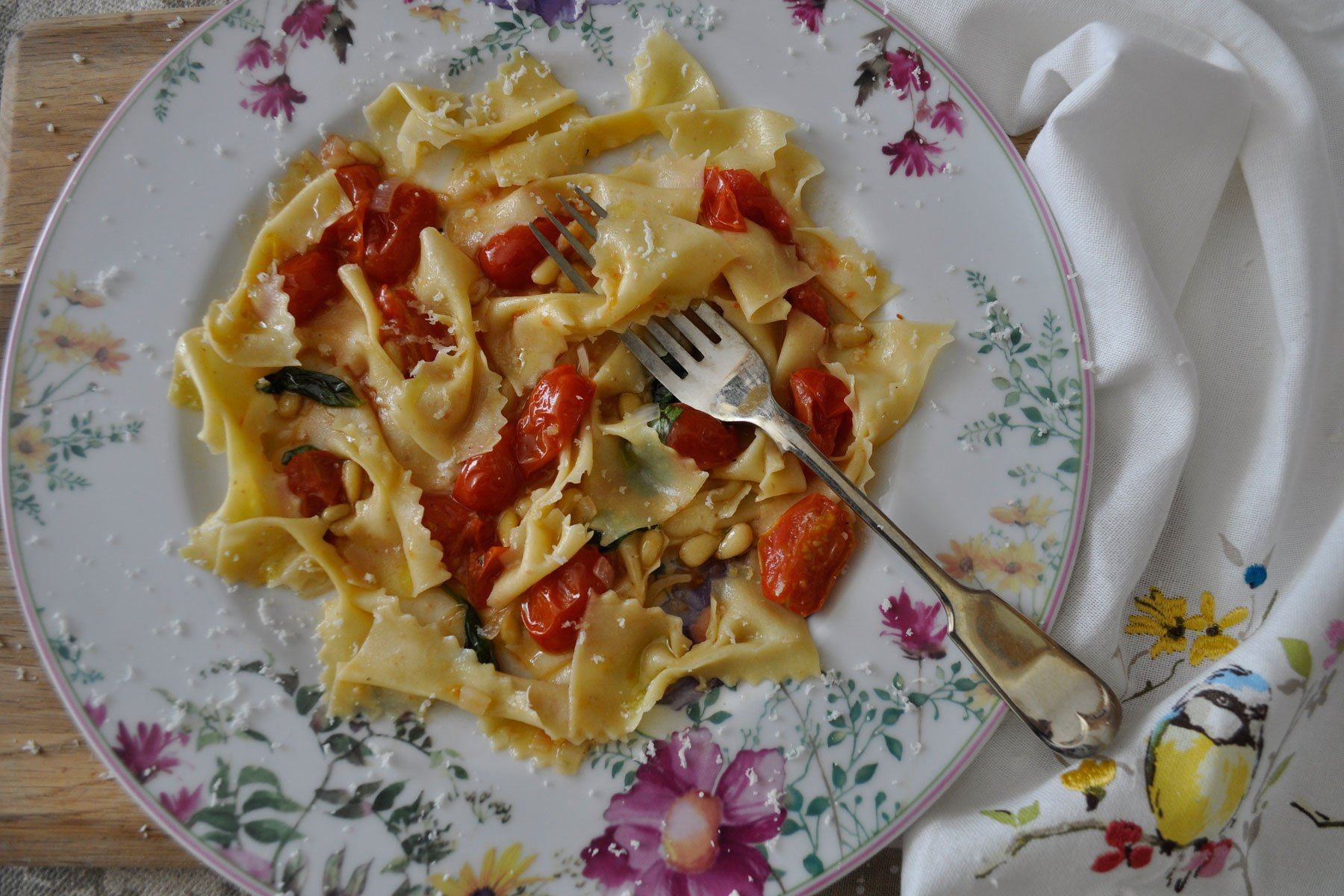 Fava Farfalle with Pinenuts and Tomato