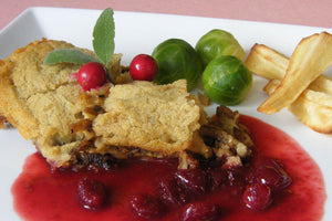 Sage and Onion Fava Bean Bake with Boozy Cranberry Sauce