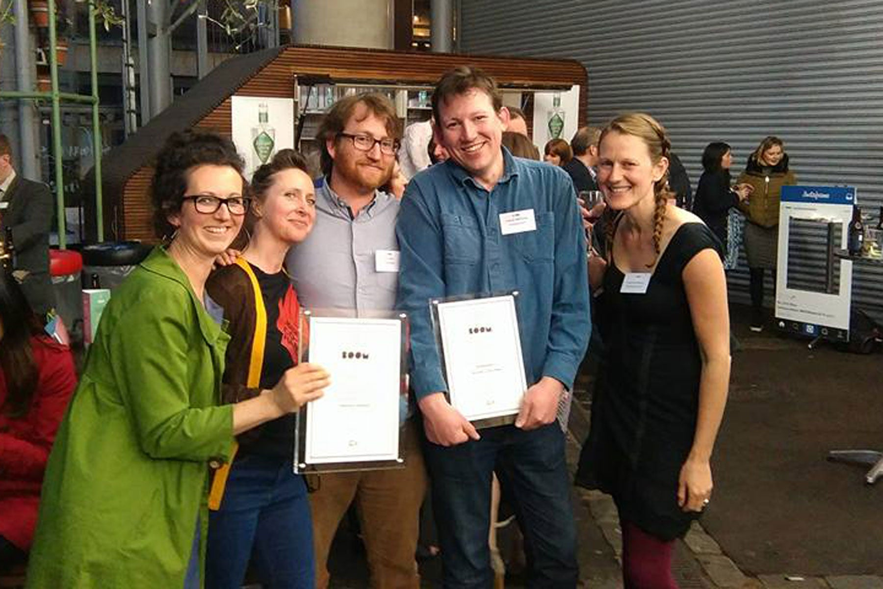 Josiah and Joe with our BOOM Award and friends from Unicorn Grocery