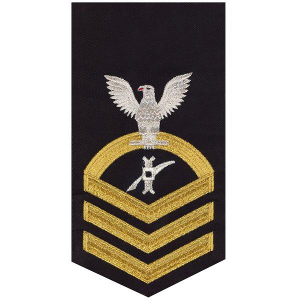 Navy E7 Rating Badge: Legalman - seaworthy gold on blue