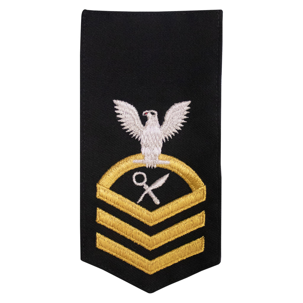 Navy E7 FEMALE Rating Badge: IS Intelligence Specialist - seaworthy gold on blue