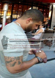 Football-Autographed - Shawne Merriman Signing NFL Wilson Composite Football, Proof Photo