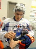 Hockey Pucks- Autographed- Anton Lander Signing Hockey Puck, Proof Photo- Edmonton Oilers