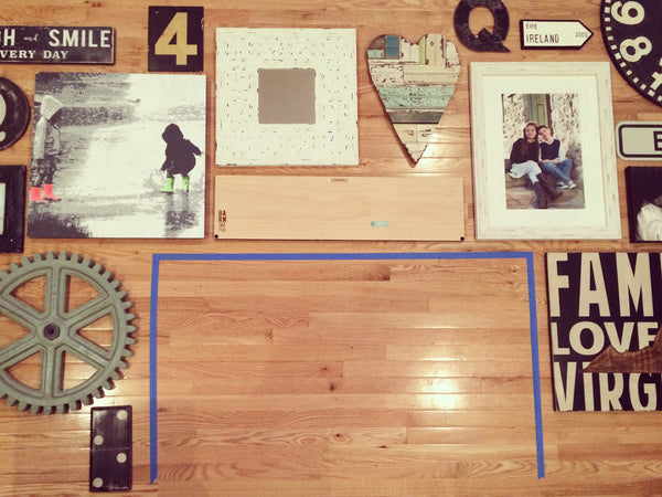 lay out your gallery wall on the floor to make a plan before you start hanging things on the wall.