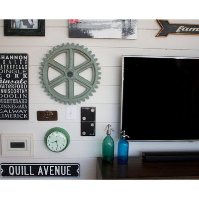 gallery wall with personalized vintage inspired street sign