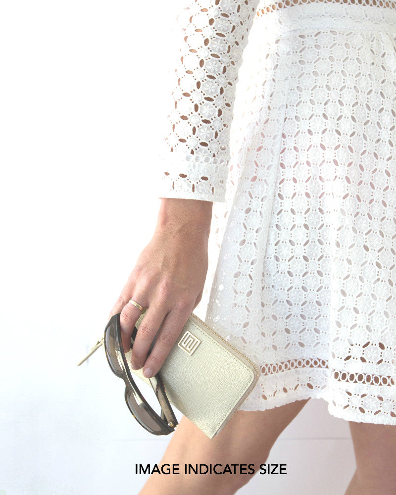 Designer wallet shown with zimmerman dress and prada sunglasses