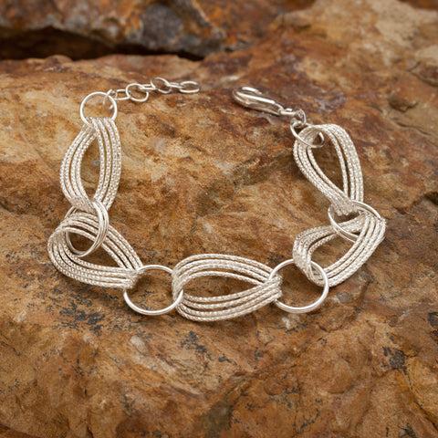 Woven Infinity Sterling Silver and Rhodium Bracelet
