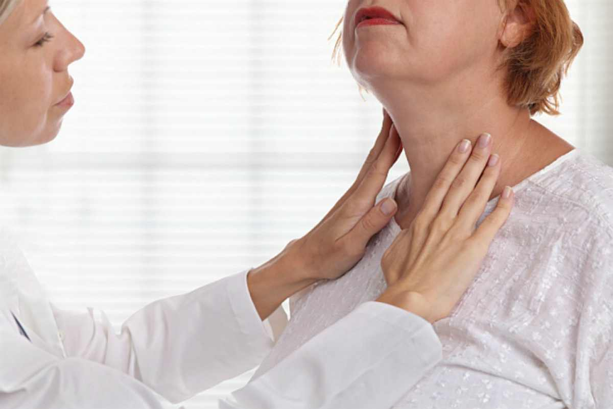 Doctor checking for lumps | How To Tell If You Have Hypothyroid