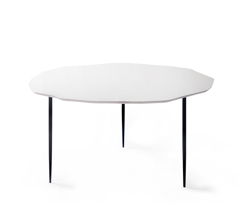 irregularly shaped white table top with 3 black legs on white background