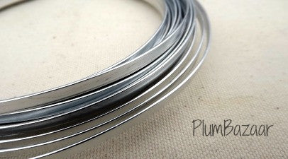 Aluminum wire for jewelry or crafts, 5mm flat, 24 ft. coil, silver