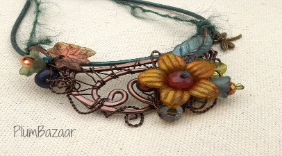 Wire and leather necklace with hand painted flowers