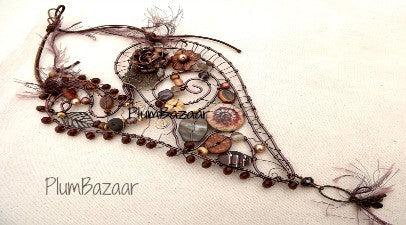 Handmade wire wall hanging, whimsical beaded heart in brown tones