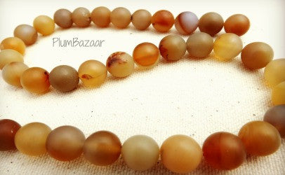 "Smooth agate beads with matte finish, 10mm round, 15"" strand"