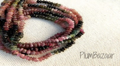 "Tourmaline, 15"" strand of 3mm spacer beads in graduated colors"