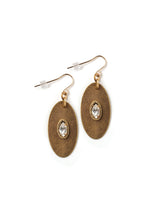 Front view of modern oval drop earrings in antique gold with rhinestone navette accents