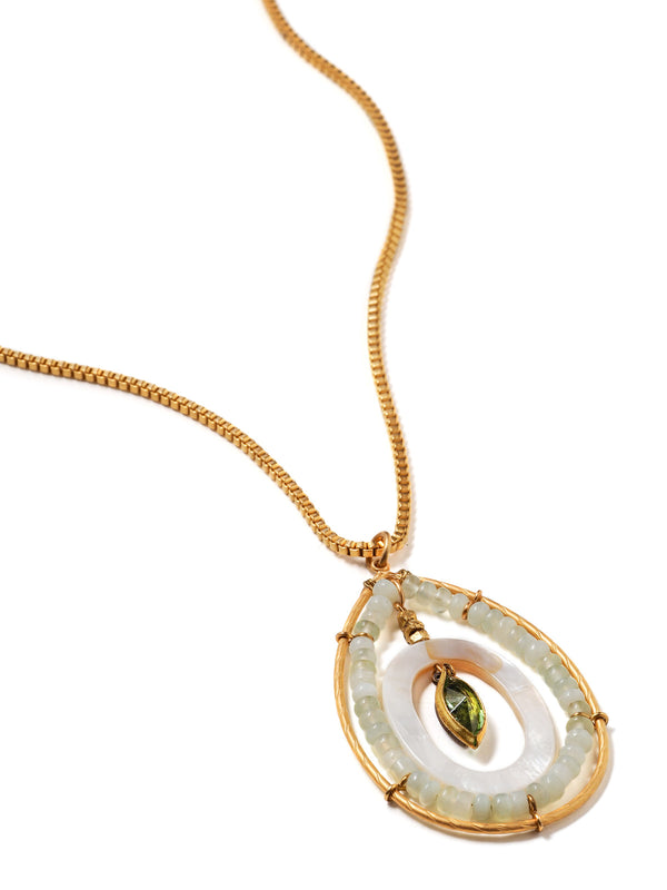 close up of beaded teardrop shaped pendant on box chain in bright gold